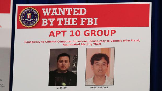 2018年12月20日,美国司法部对两名中国籍男子发布通缉令,两人疑联同黑客组织APT10盗取美国公司的资料。(美联社)