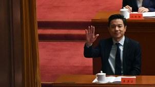 2018年12月18日,百度創始人及CEO李彥宏在北京人民大會堂出席改革開放40周年慶祝大會。(法新社)