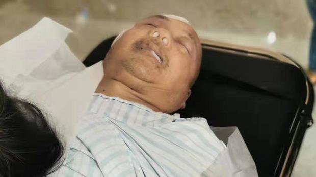 2019年10月26日,身體一向正常的陳春章在醫院裏昏迷不醒。(葉木蘭提供)